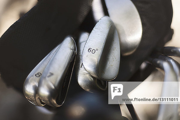 Overhead view of golf clubs in bag