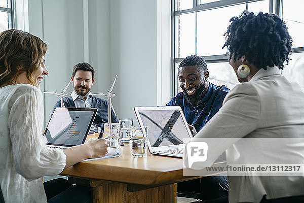 Smiling business people during meeting in office