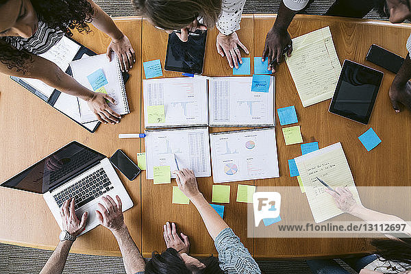 High angle view of business people planning in board room