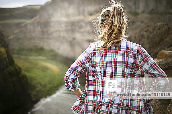 Rear view of female hiker visiting mountains