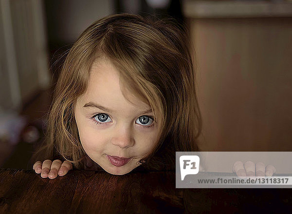 Close-up of portrait of cute girl at home