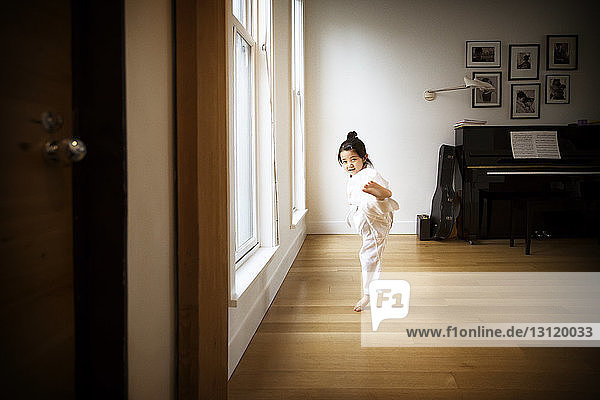 Girl practicing karate at home