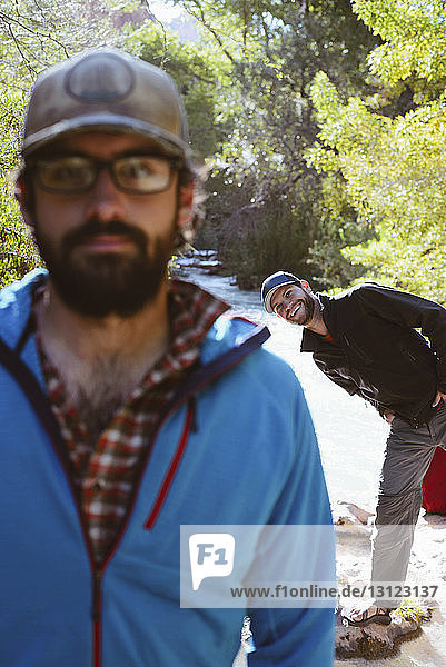 Portrait of happy brothers enjoying in forest