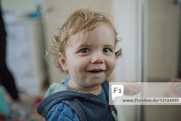 Portrait of cute baby boy at home