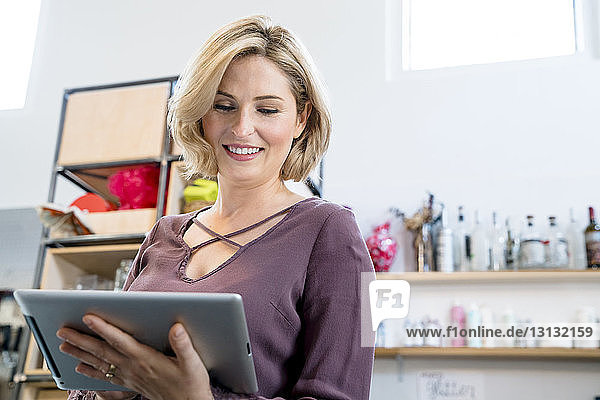 Low angle view of businesswoman using tablet computer in office