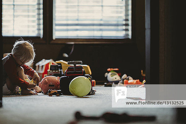 Boy playing with toys at home