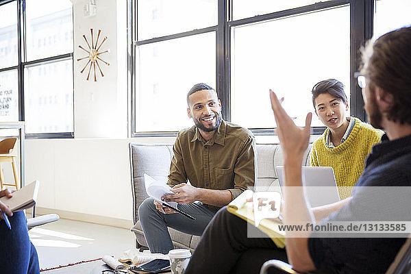Entrepreneurs brainstorming in meeting at office