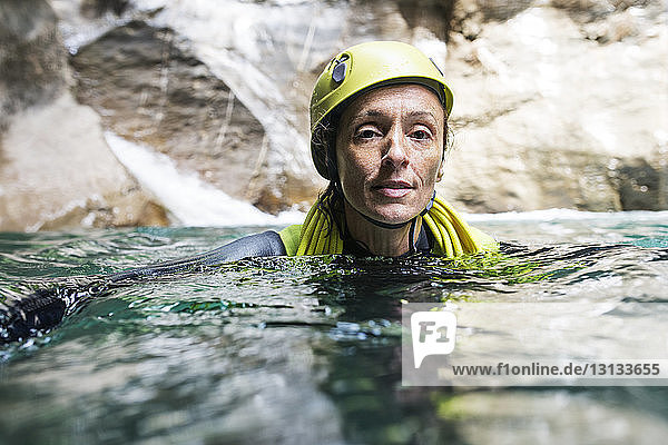 Portrait of mature female scuba diver in river