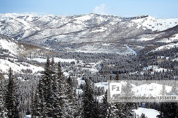 Scenic view of snow covered valley and mountains