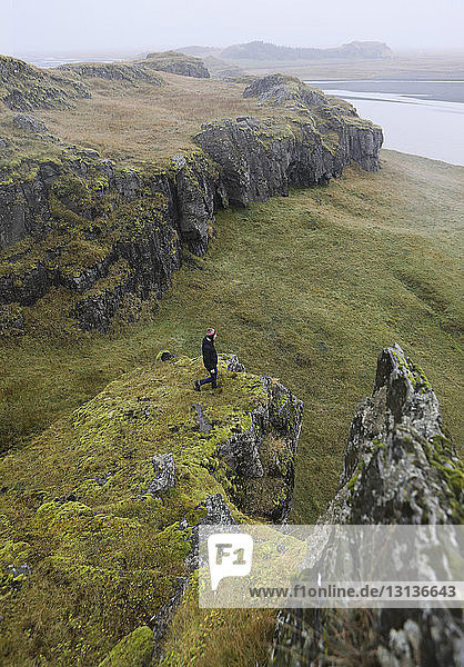High angle view of hiker standing on mountain