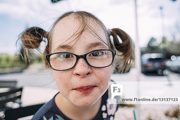 Portrait of girl in eyeglasses at sidewalk cafe