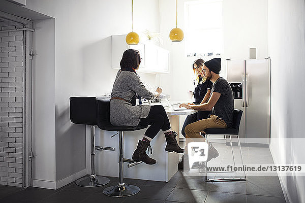 Business people working at cafeteria in creative office