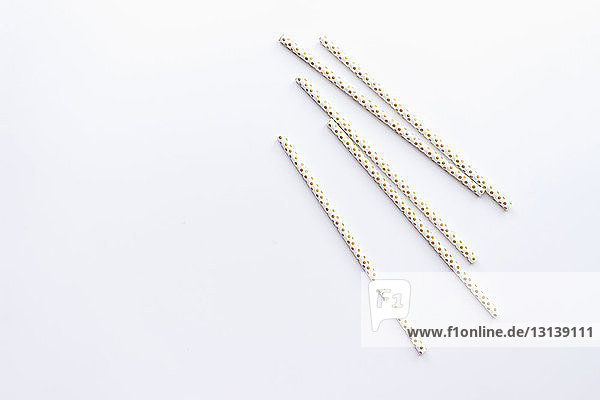 High angle view of drinking straws on white background