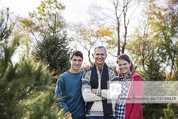 Portrait of smiling family standing in farm