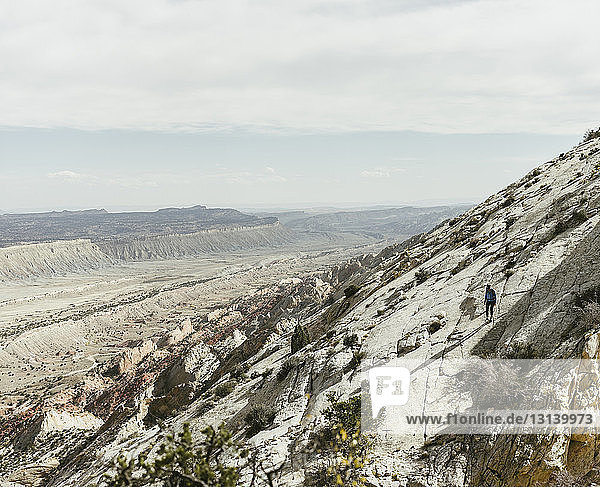 High angle view of hiker on mountain against sky