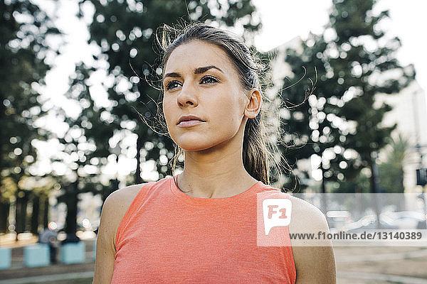Thoughtful female athlete at park