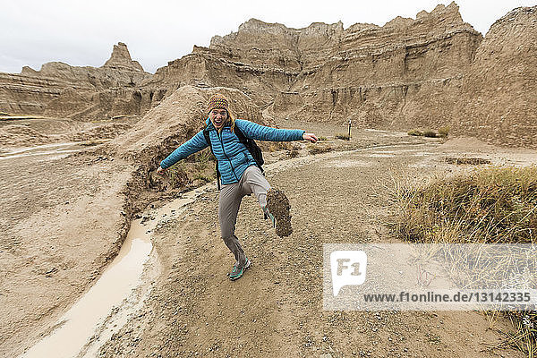 Portrait of woman standing on rock formation