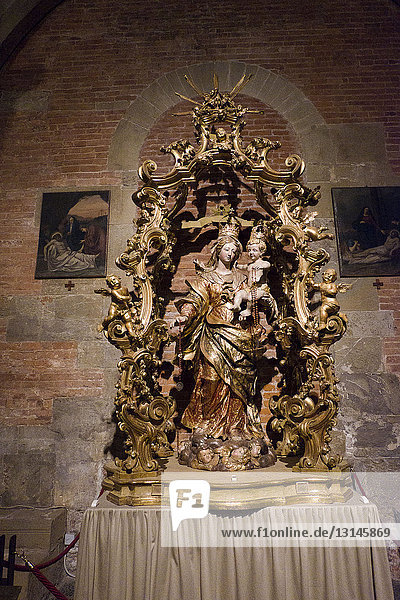 Italy  Lombardy  Pavia  Basilica of San Michele Maggiore  a medieval Romanesque church where Frederick I  the Barbarossa  was crowned King of Italy on April 17  1155. wooden statue of the Madonna del Rosario