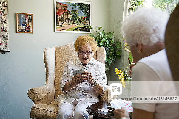 Mature ladies playing cards together