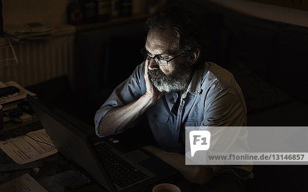Mature man working late