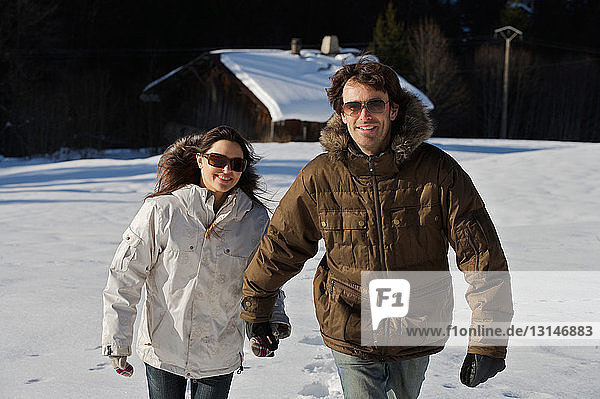 Couple walking in the snow. Couple walking in the snow.