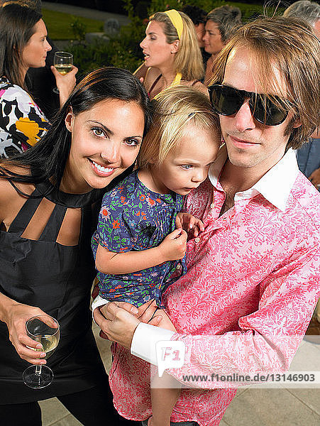 Couple with baby at a cocktail party