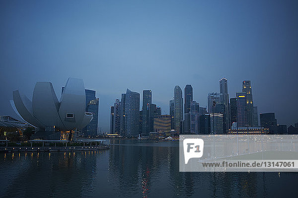 View of city skyscrapers and waterfront at dawn  Singapore