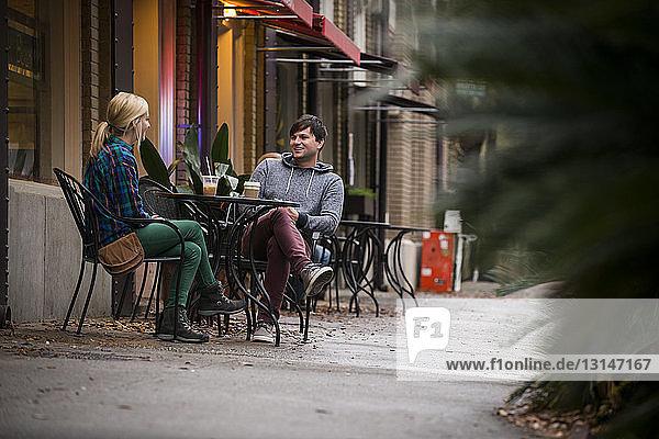 Couple having coffee at sidewalk cafe  Savannah  Georgia  USA