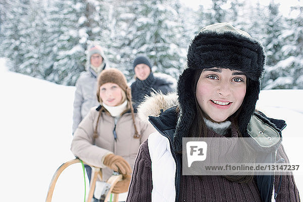 Teenagers in winter landscape
