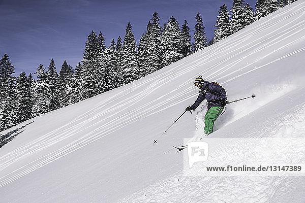 Man skiing down steep slope  Spitzingsee  Germany