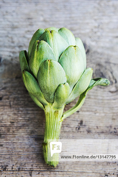 Artichoke on wooden floor