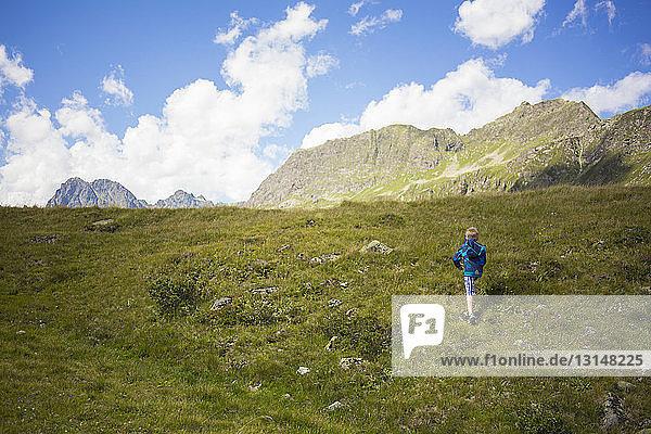 Boy walking up mountainside  Tyrol  Austria Boy walking up mountainside, Tyrol, Austria