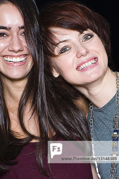 Portrait of two female friends  smiling