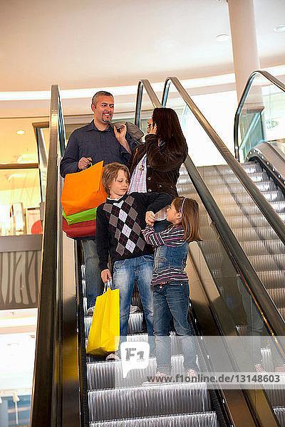 Family on an escalator