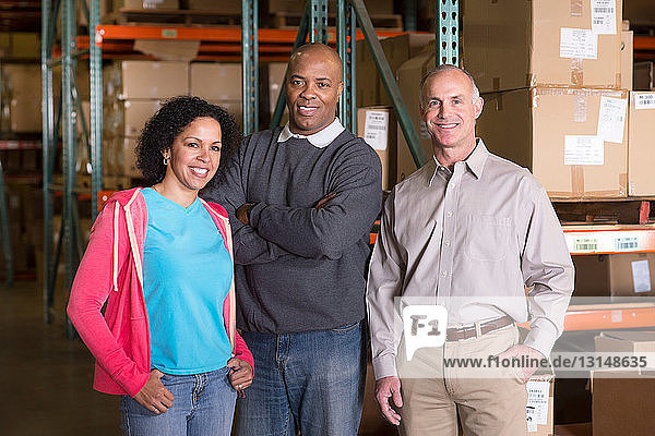 Portrait of three warehouse workers