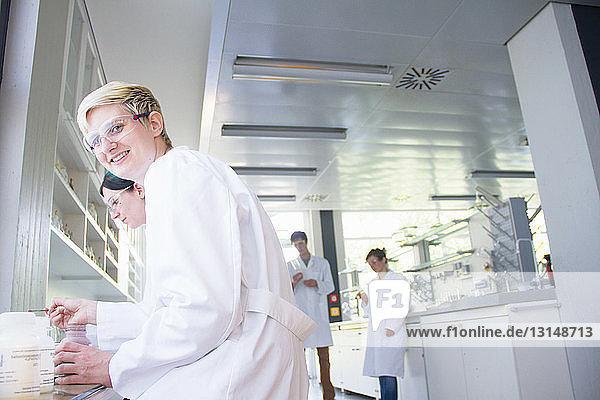 Chemistry student sitting in laboratory  portrait
