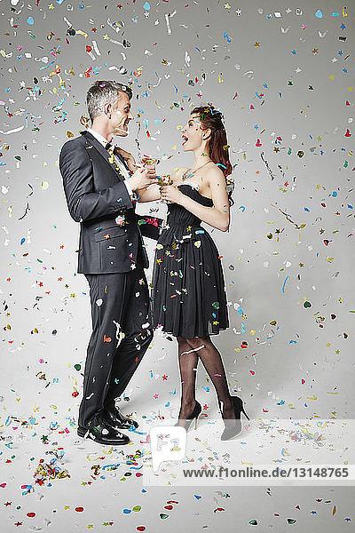 Portrait of couple celebrating with toast