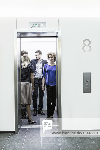 Businesspeople standing in lift