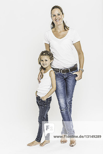 Portrait of mother and daughter  full length