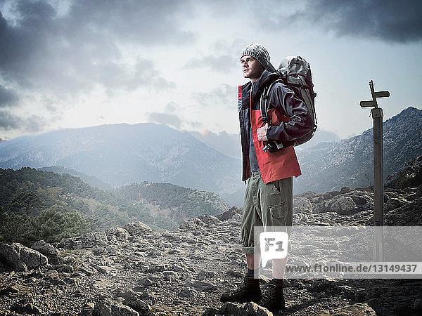 Hiker standing in rocky terrain