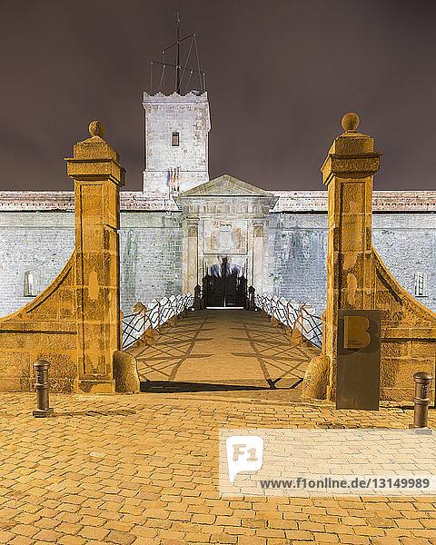 Entrance bridge of Montjuic Castle at night  Barcelona  Catalonia  Spain Entrance bridge of Montjuic Castle at night, Barcelona, Catalonia, Spain