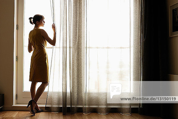 Woman looking at a window