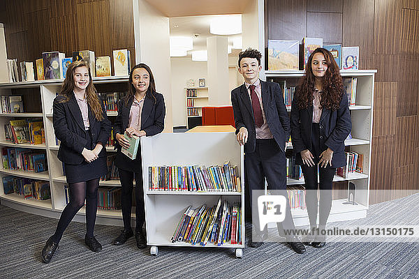 Group of students posing in library