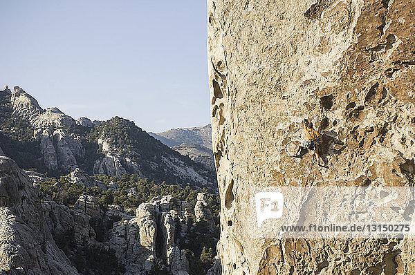 'Man climbing ''Tribal Boundaries'' 5.10a - Flaming Rock  City of Rocks  Idaho  USA'