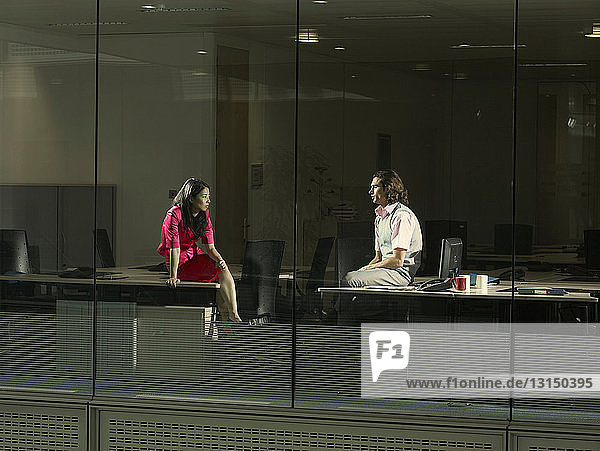 Two people sitting in an office Two people sitting in an office
