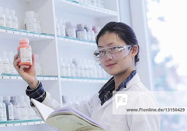 Scientist holding bottle in lab