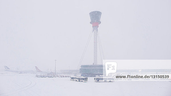 Air control tower and airport in snow