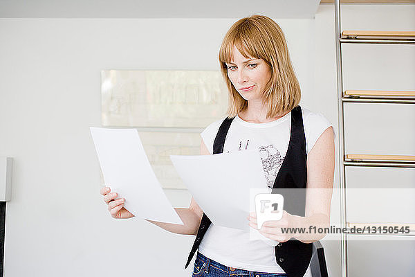 Businesswoman studying papers