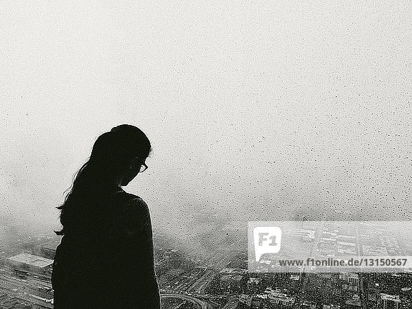 Silhouette of woman gazing over Chicago city  Illinois  USA