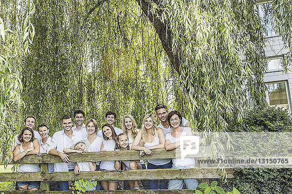 Portrait of group of people standing behind fence